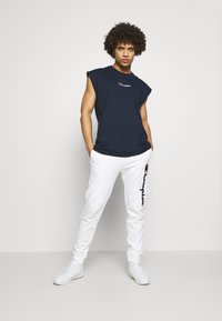 Champion - ROCHESTER CUFF PANTS - Spodnie treningowe - white - 1