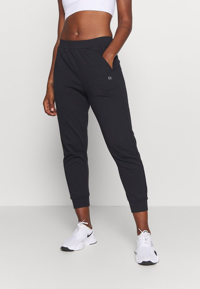 PANTS - Tracksuit bottoms - black