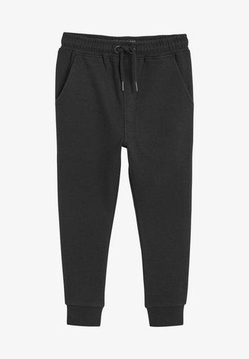 SPRAY ON - Tracksuit bottoms - black