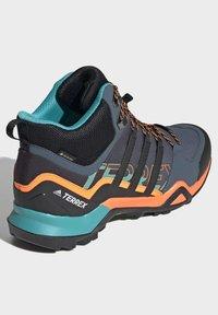 adidas Performance - TERREX SWIFT R2 MID GORE-TEX HIKING SHOES - Hiking shoes - green - 4
