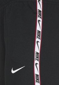Nike Sportswear - REPEAT  - Spodnie treningowe - black - 2