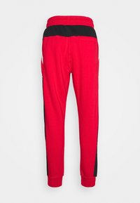 Nike Sportswear - AIR - Tracksuit bottoms - university red/black/white - 7