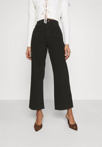 HIGHWAIST - Flared Jeans - washed black