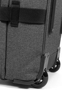 Eastpak - TRANVERZ - Wheeled suitcase - black denim - 5
