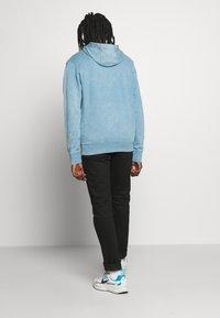 Nike Sportswear - HOODIE WASH - Hoodie - light blue - 2