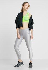 Nike Performance - FE/NOM FLYKNIT BRA - Medium support sports bra - volt/pure platinum - 1