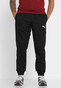 Puma - ACTIVE PANTS  - Pantalon de survêtement - puma black - 0