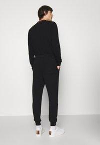 Vivienne Westwood - CLASSIC - Tracksuit bottoms - black - 2