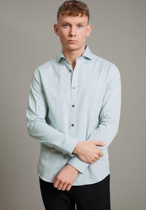 Camisa elegante - caneel bay