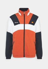 Ellesse - GONZAGA JACKET - Lehká bunda - dark orange - 0