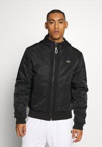 Lacoste Sport - PREMIUMI JACKET - Winter jacket - black - 0
