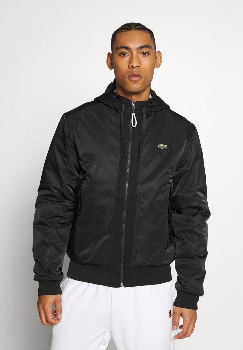 Lacoste Sport - PREMIUMI JACKET - Winter jacket - black