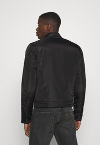 Calvin Klein Jeans - PADDED MOTO JACKET - Light jacket - black - 2