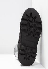 Calvin Klein Jeans - DIAHNE - Platform ankle boots - black - 6