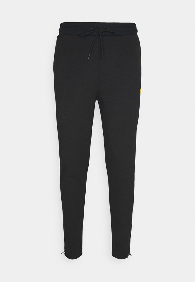 TECH TRACKIES - Trainingsbroek - true black