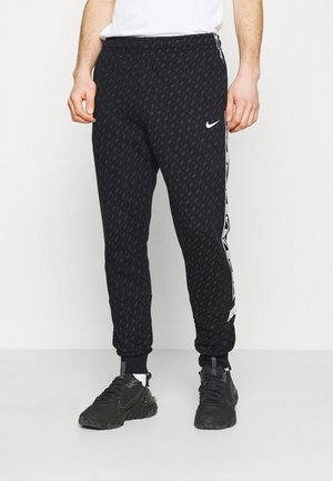 REPEAT PRINT - Tracksuit bottoms - black/white