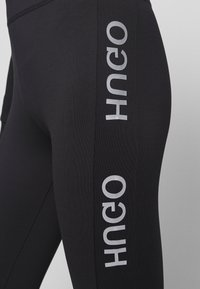 HUGO - NEFLECTIVE - Leggings - Hosen - black - 6
