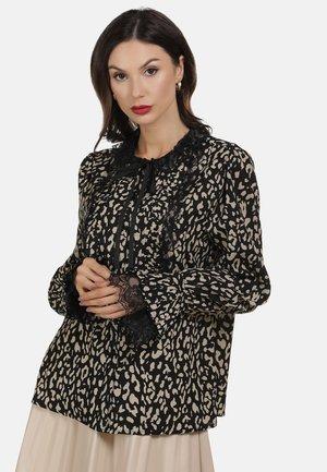 Blusa - leopard