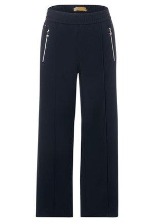 MIT ZIPPERN - Trousers - blau