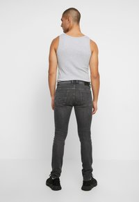 Diesel - THOMMER-X - Jean slim - grey denim