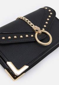 ALDO - Across body bag - jet black/light gold-coloured - 6