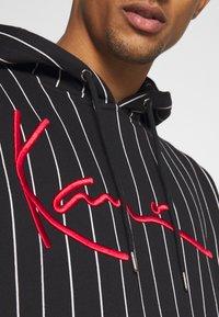 Karl Kani - SIGNATURE PINSTRIPE HOODIE UNISEX  - Hoodie - black - 6