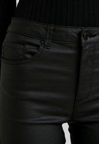 Vero Moda - VMSOPHIA COATED PANTS - Trousers - black - 3