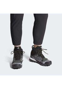 adidas Performance - TERREX SKYCHASER GORE-TEX BOOST HIKING SHOES - Fjellsko - grey - 0
