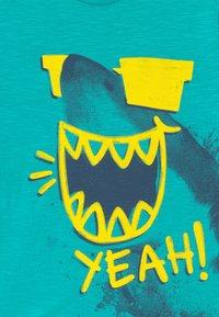 Benetton - T-shirt con stampa - light blue - 3