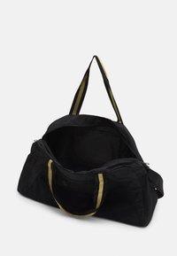 Puma - GRIP BAG 25 L - Sportovní taška - black/bright gold - 3