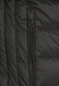 Tommy Hilfiger - PACKABLE HOODED JACKET - Gewatteerde jas - black - 7