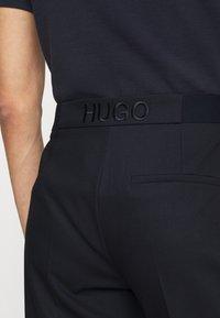 HUGO - HALERA - Trousers - open blue - 3