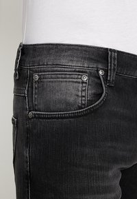 Nudie Jeans - GRIM TIM - Vaqueros slim fit - concrete black - 5
