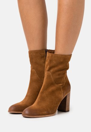 High heeled ankle boots - tan