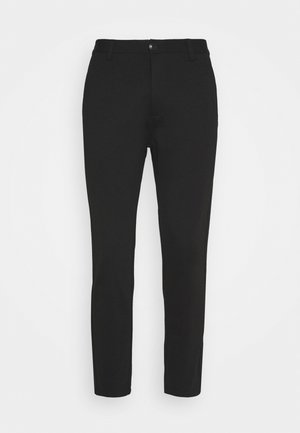 VERTY - Trousers - black