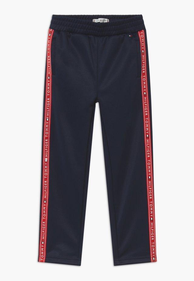 TAPE TRACKPANTS - Teplákové kalhoty - blue