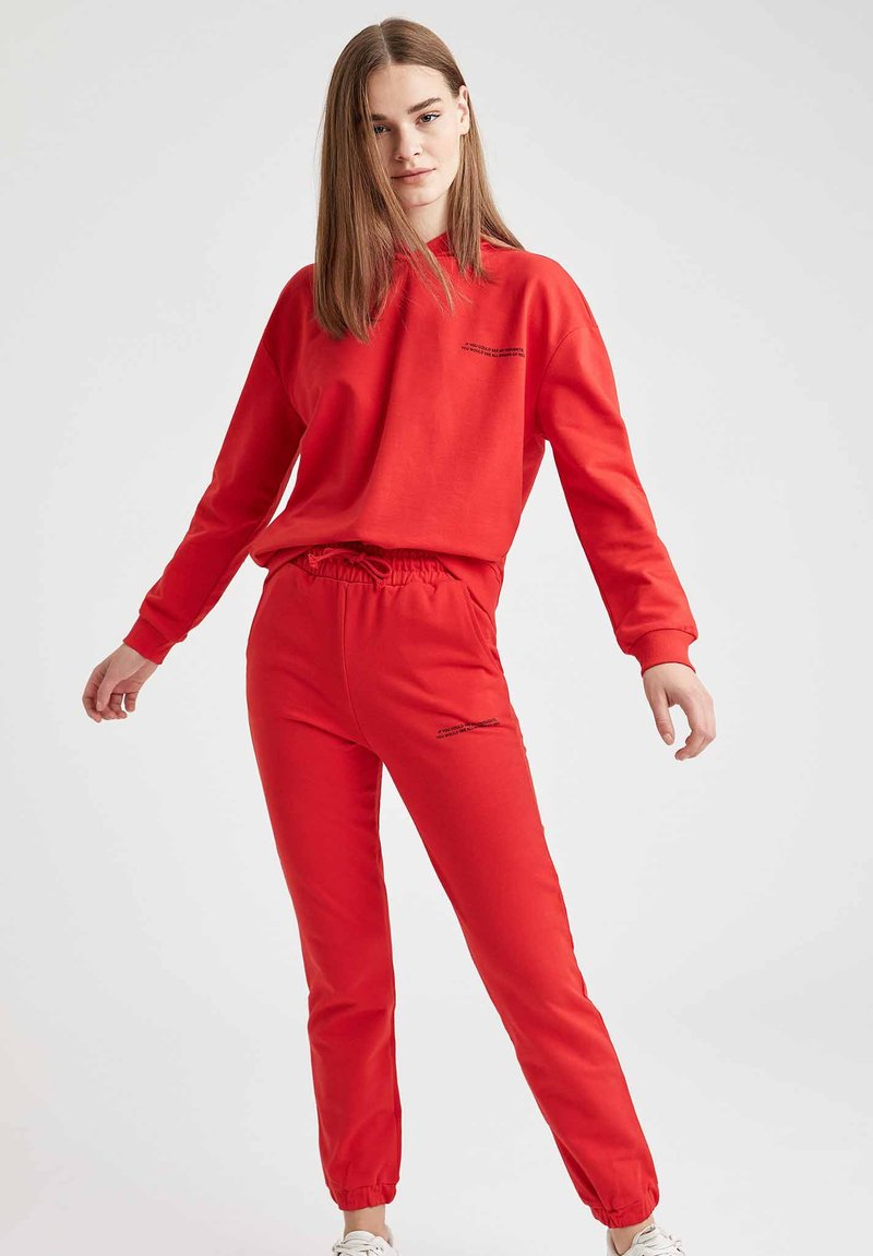 DeFacto - Tracksuit bottoms - red