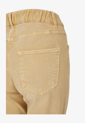 TAMA - Straight leg jeans - sand