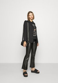 ONLY - ONLCOOL FLARED - Trousers - black - 1
