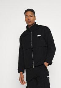 Mennace - CRINKLE TECH TRACKSUIT JACKET - Summer jacket - black - 0