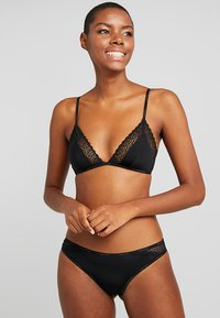 Calvin Klein Underwear - FLIRTY UNLINED - Reggiseno a triangolo - black - 1