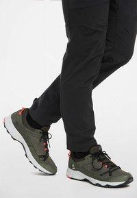Haglöfs - TRAIL FUSE - Hiking shoes - deep woods/true black - 0