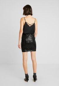 Gina Tricot - EXCLUSIVE HOLLY GLITTER SKIRT - Minisukně - black - 2