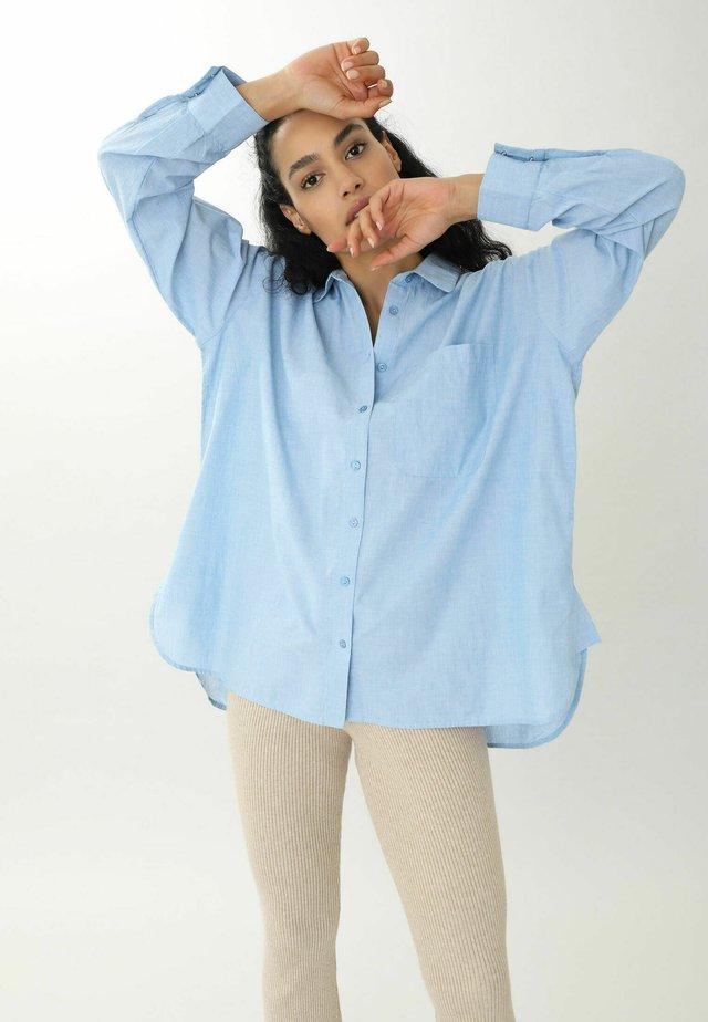 Skjorta - himmelblau