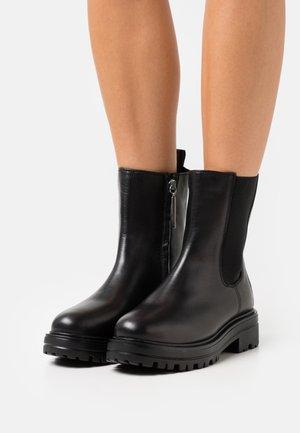 MARSTA - Kotníkové boty - black