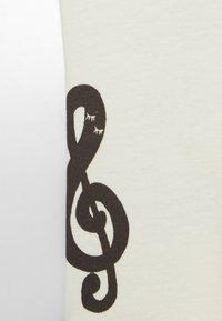 Mini Rodini - BABY NOTES UNISEX - Leggings - Trousers - offwhite - 2