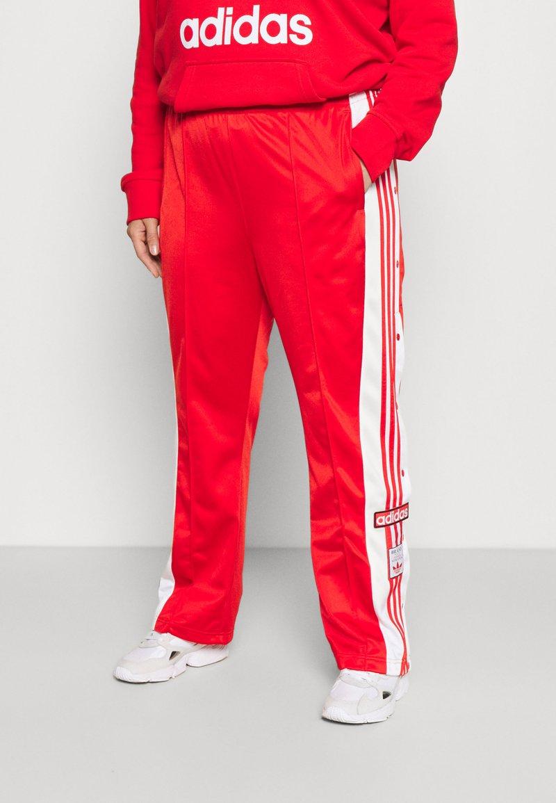 adidas Originals - ADIBREAK - Trainingsbroek - red