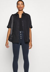 Calvin Klein Jeans - HIGH RISE SUPER SKINNY - Jeans Skinny Fit - dark blue denim - 4