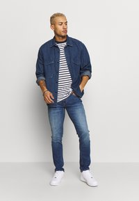 Tommy Jeans - SCANTON - Slim fit jeans - blue denim - 1