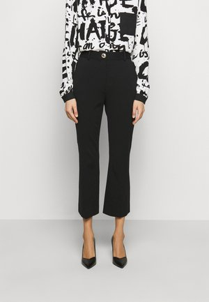 TAYTUM - Trousers - black